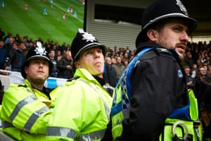 Police watch the action.