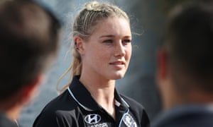 Prime minister Scott Morrison says trolls who targeted AFLW player Tayla Harris on social media are 'cowardly grubs'