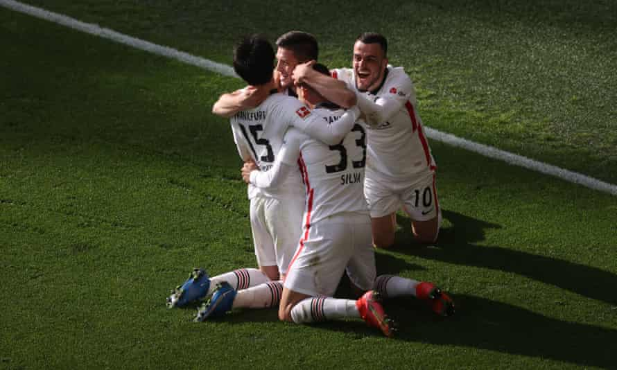 Andre Silva celebrates with his teammates after scoring a goal that pushed Frankfurt closer to Champions League qualification