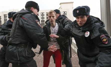 Police officers detain a demonstrator after the Free Internet rally in March, organised in response to the bill.