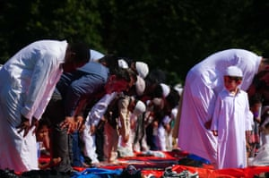 People during morning prayer during Eid al-Adha, or festival of sacrifice, in Southall Park, Uxbridge