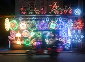 A shop in San Fernando sells fairy lights and artificial trees