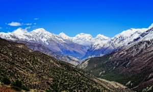 Himalayas mountain valley view with white mountain peaks.