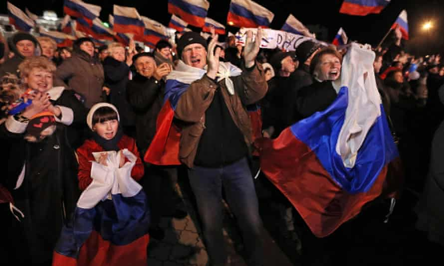 Crimean residents celebrate the region's accession to Russia, in March 2014.