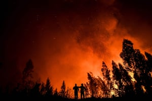 Firefighters monitor the progression of a wildfire at Amendoa in Macao.