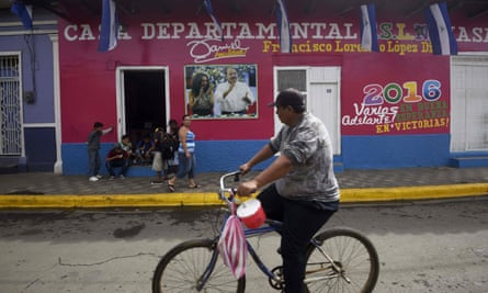 A man cycles past a Sandinista National Liberation Front (FSLN) local headquarters in Masaya, Nicaragua
