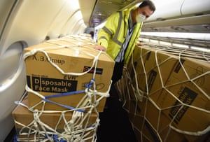Boxes containing face masks are unloaded from a plane on May 23, 2020 in Bournemouth