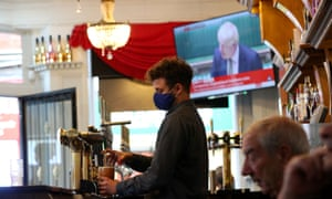 Coronavirus - Mon Oct 12, 2020<br>A member of staff pours a drink in the Richmond pub in Liverpool as Prime Minister Boris Johnson reads a statement on television, as parts of the North of England are bracing themselves for the most stringent Tier 3 controls, with Merseyside expected to have its pubs, gyms and casinos closed in a bid to suppress its infection rate. PA Photo. Picture date: Monday October 12, 2020. See PA story HEALTH Coronavirus. Photo credit should read: Peter Byrne/PA Wire