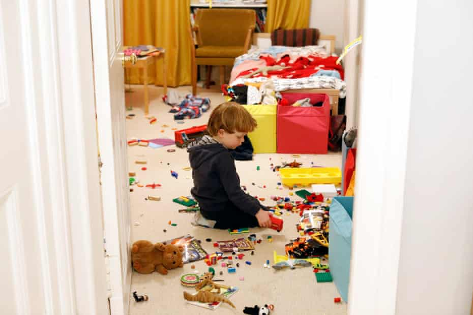Francis passes time alone playing in his room.