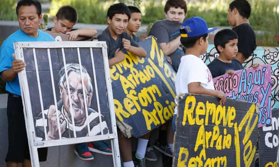 People protest against former sheriff Jo Ar Payo in front of the Maricopa County Sheriff's Office in Phoenix on May 25, 2016.