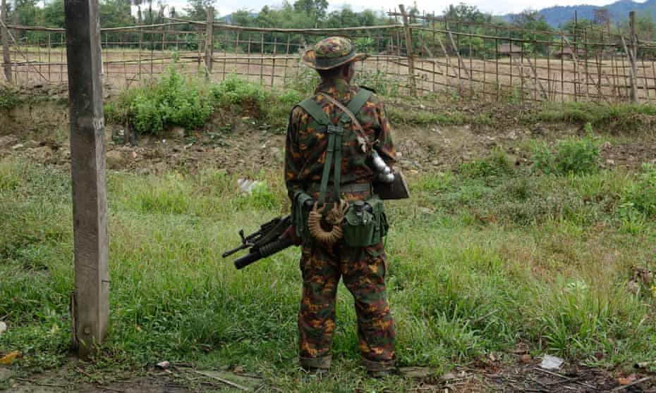 An armed soldier stand guards in Rakhine state, western Myanmar