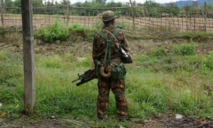 A soldier stand guards in Maungdaw township, Rakhine state, western Myanmar.