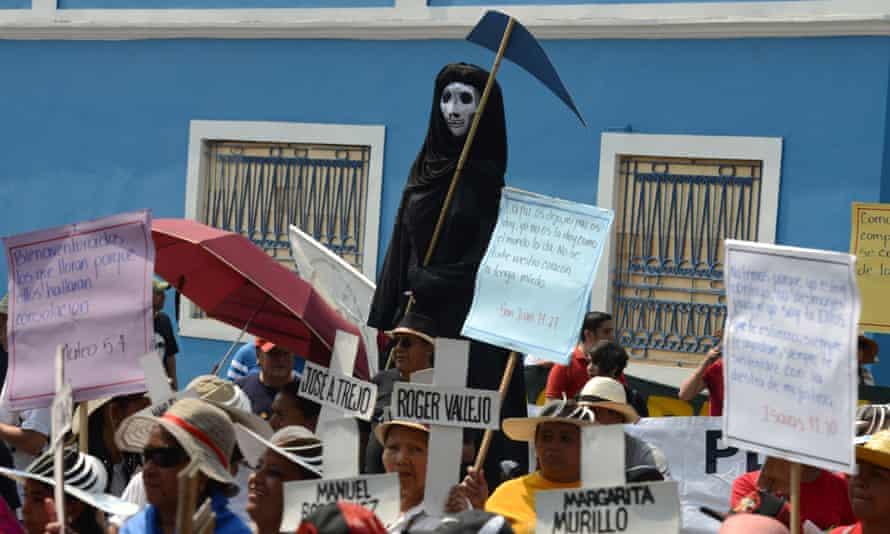 Demonstrators demand justice following the murder of Honduran activist Berta Cáceres in 2016