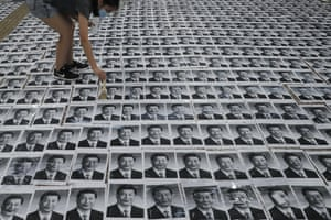 """Hong Kong, ChinaA youngster sticks posters of Chinese President Xi Jinping on the floor as part of a newly created Lennon Wall. Hong Kong police warned Monday of the potential for protesters in the semi-autonomous Chinese territory to engage in violence """"one step closer to terrorism"""""""