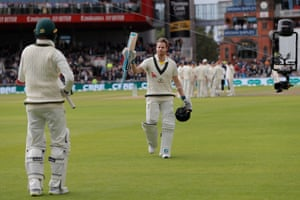 Australia's Steve Smith raises his bat in appreciation of the standing ovation he receives as he leaves the field after losing his wicket for 211.