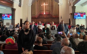 """Attendees stand and turn their backs on Mike Bloomberg during a commemoration ceremony for the 55th anniversary of the """"Bloody Sunday"""" march in Selma, Alabama"""