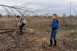 Joey and Jackson collect sticks for a fire in the field in New Lenox, IL on November 20, 2020.