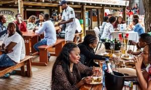 Diners at the Sakhumzi restaurant on Vilakazi Street, Soweto.
