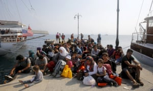 Syrian refugees wait to be documented by Greek coast guards on the island of Kos, after crossing the Aegean sea from Turkey in August 2015.
