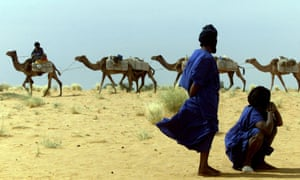 Nomadic herders and a camel caravan on the road to Timbuktu.