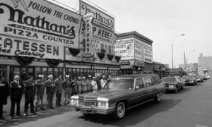 Employees of Nathan's Famous line up to pay their respects as the hearse bearing the body of Nathan Handwerker passes by in 1974