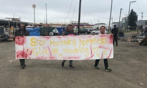 Oakland homeless activists protest real estate developer Gene Gorelik who offered people in a homeless encampment $2,000 in hopes of getting them to leave.