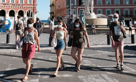 People wearing masks in central Nice, France.