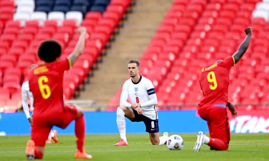 Jordan Henderson taking the knee before England's Nations League match against Belgium in October.