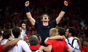 Andy Murray is mobbed by his team-mates after beating David Goffin to win the Davis Cup Final.