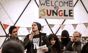 Jude Law (centre) speaks during a visit to the 'Jungle' migrant camp in Calais on 21 February to draw attention to the plight of refugees facing imminent eviction.