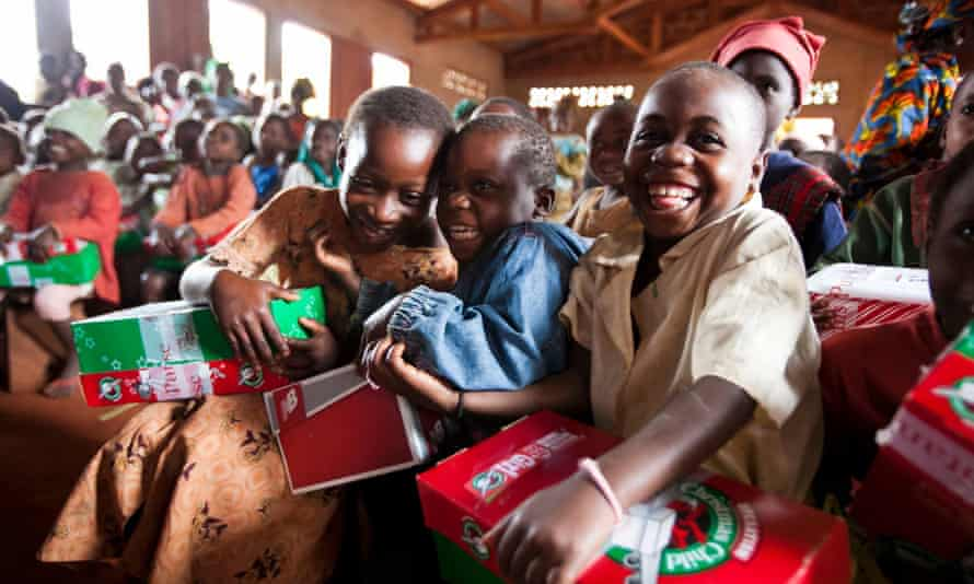 Children receiving Operation Christmas Child boxes