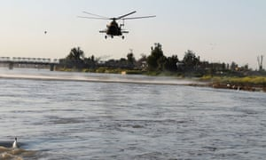 An Iraqi army helicopter searches for survivors
