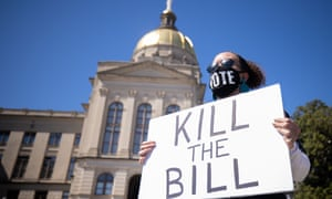 Opponents of Republican backed bills accused of purporting voter suppression, hold a protest outside the Georgia state capitol building on Monday.