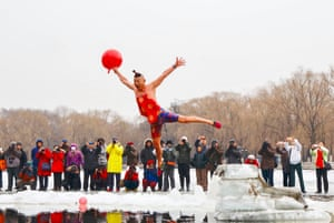 A man in  Shenyang, China leaps into a freezing lake to mark the Lantern festival on 19 February, the 15th day of the lunar new year