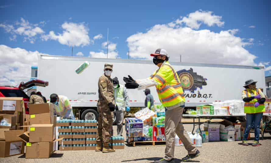 The Navajo Nation president, Jonathan Nez, helps distribute supplies to Navajo families on the Navajo Nation in May.