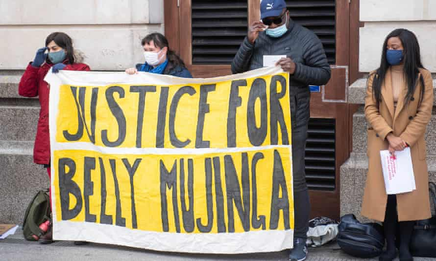 Lusamba Katalay, the husband of Belly Mujinga, joins activists for a vigil at Victoria station in London to mark one year since her death