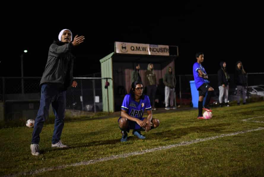 Muhammed Ebarahim, a former refugee and member of QR The Brave FC, watches his team.