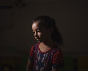 Maya Abu Muawad, eight, at a school run by the UN where her family is taking shelter after their home was destroyed during an 11-day war in northern Gaza Strip. After Israeli airstrikes on the family's home, Maya was separated from her mother. Alone and afraid, she rode in an ambulance to safer ground. For 15 minutes, she was locked in the wailing vehicle with a dying person and a wounded boy, her neighbour