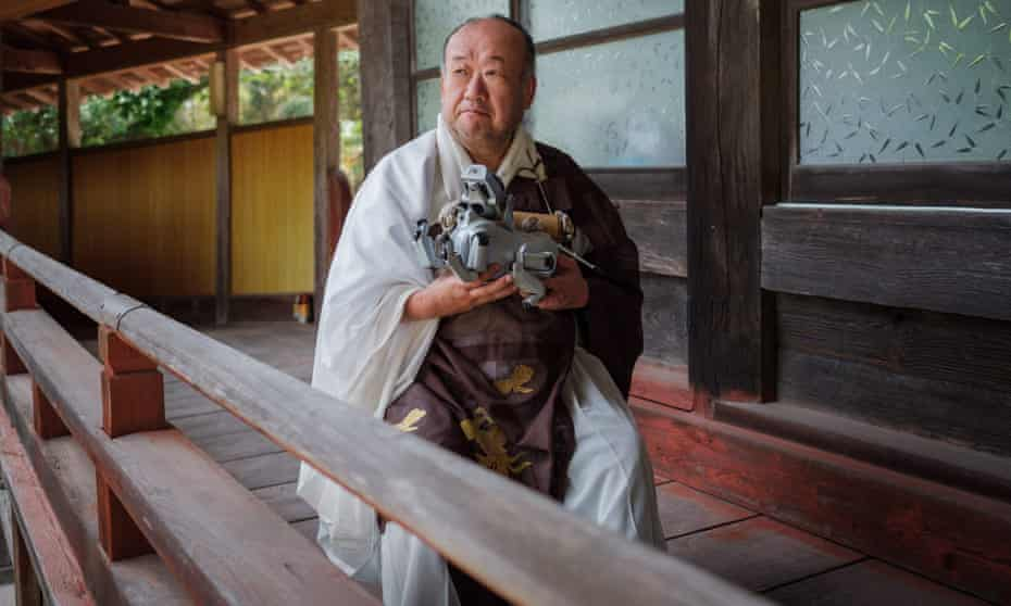 Kofukuji temple chief priest Bungen Oi holds a pet Aibo robot dog after a robots' funeral
