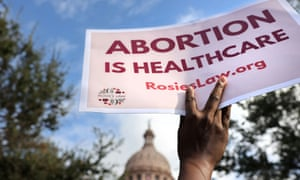 A supporter of reproductive rights holds a sign outside the Texas state capitol, 2 October.