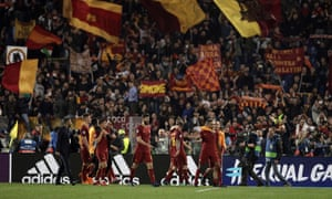 Roma players celebrate in front of the home fans at the final whistle.