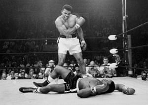 Muhammad Ali, then known as Cassius Clay, stands over challenger Sonny Liston, in 1965.