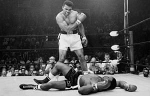 Muhammad Ali, then known as Cassius Clay, stands over Sonny Liston in their 1965 rematch