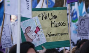 Thousands of people holding banners and posters stage a protest to condemn violence against women in Buenos Aires, Argentina