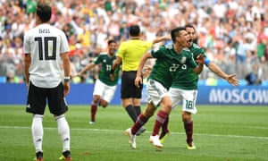 Hirving Lozano (No 22) celebrates his first-half winner for Germany as Mesut Özil looks dejected.