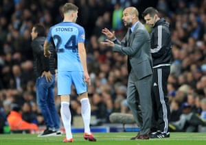 Manchester City manager Pep Guardiola instructs John Stones during the Champions League win over Barcelona.