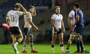 Harris, Fagerson and Hogg of Scotland cut dejected figures at the final whistle
