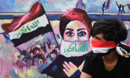 A protester in Baghdad after the prime minister's resignation in December.
