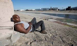 Juan King near the LA River, one of the places he lived when he was homeless.