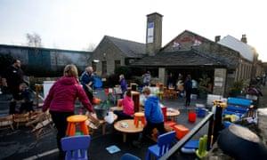 People help to clean water logged items at the Waterside Nursery, in Elland, Calderdale.